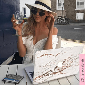 Coconut Lane's Rose Gold Marble Macbook Skin with influencer @thelaurablair