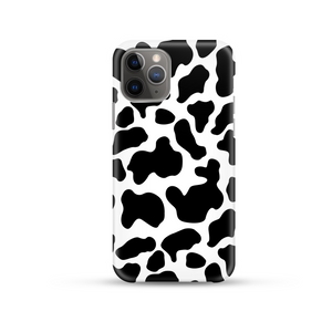 black and white cow print phone case on a white background