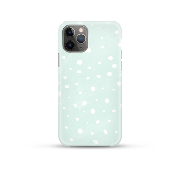 multisized white polka dot spots with a mint coloured background
