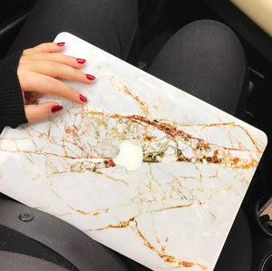 Coconut Lane's Rose Gold Marble Macbook Skin held by hand with red nails