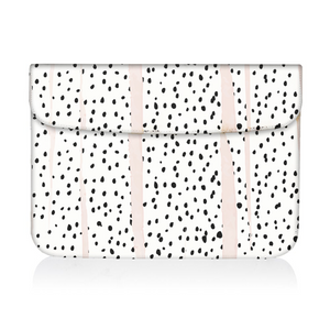 black and white dalmatian print design on laptop sleeve on white background