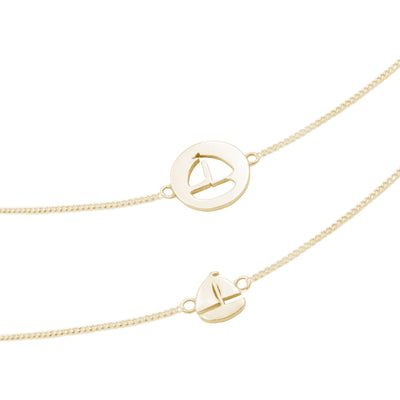 18kt gold ship  pair of necklaces
