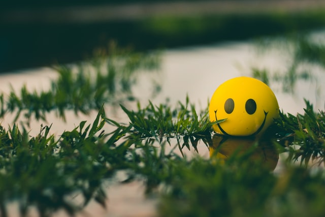 floating happy face ball