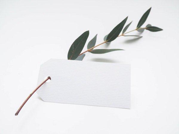 a white label on a green plant