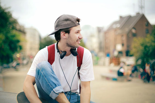man with headphones sitting down