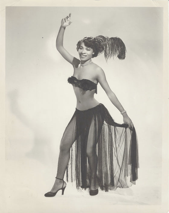 Burlesque Dancer in Long Fringe Skirt