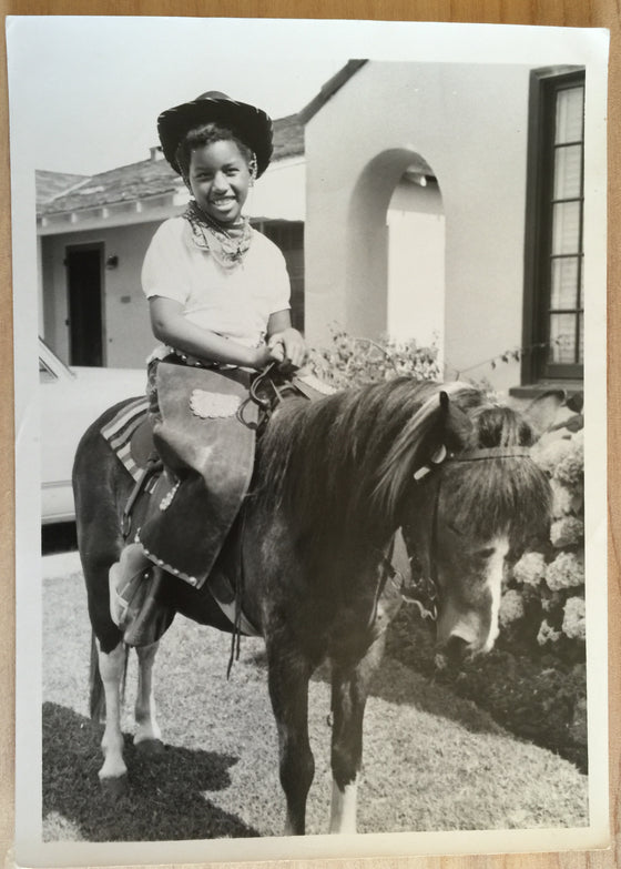Young Cowgirl on a Pony
