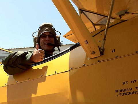 Mo Nelson of ECOMflight getting ready to takeoff in a biplane over Southern California
