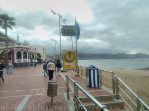 Canteras beach in Las Palmas promenade in very dark day with a lot of clouds and windy day