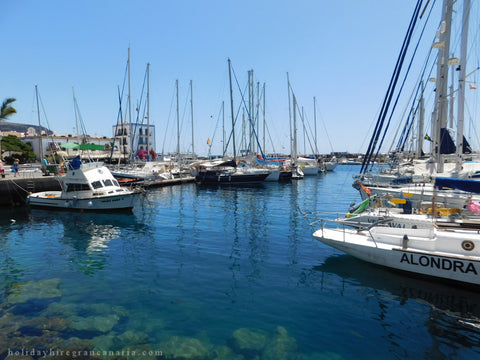 harbor in Mogan in Gran Canaria with azure water and sailboat