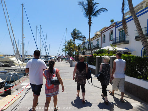 promenade in Mogan with people and restaurants, bars, palms