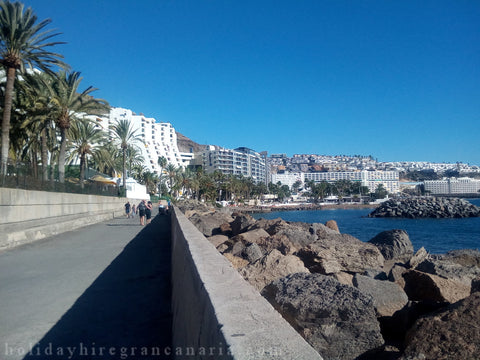 view on Arguineguin and Patalavaca in Gran Canaria with rocks, ocean and withe buildings