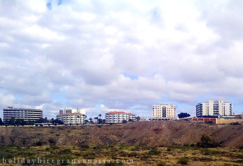 view on Playa del Ingles in Maspalomas Gran Canaria with tall buildings of hotels