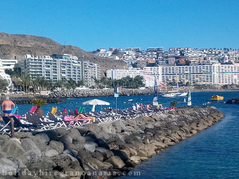 View on seaside in Patalavaca in Gran Canaria in Canary Islands with blue ocean and wall with scales