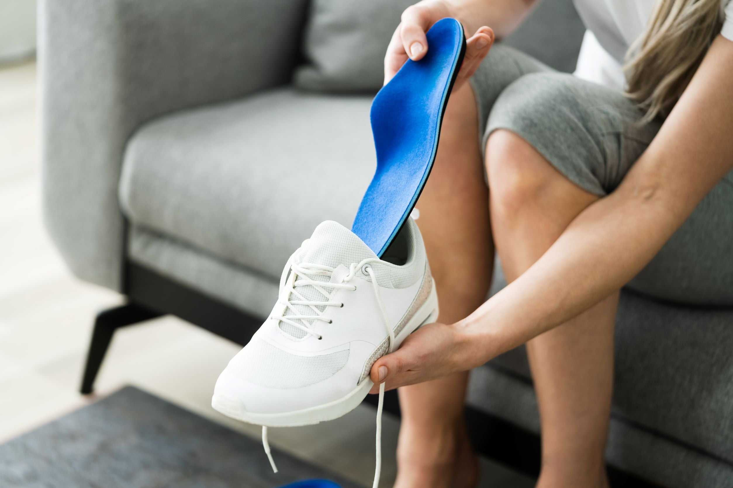 putting insole in shoe