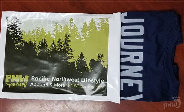 PNW Journey shirt in a shipping bag