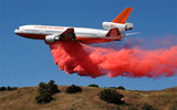 Air tanker dropping fire retardant on fire.