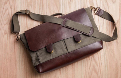 Brown leather and olive green waxed canvas messenger bag that can be used as briefcase, laptop bag and diaper bag