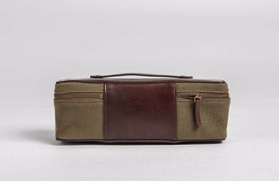 Olive green waxed canvas snack pack with brown leather top, back panel and handle