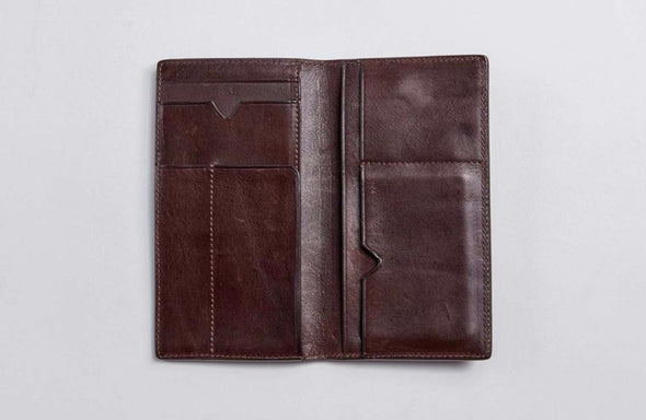 Brown leather wallet designed for working dads out on the town with their children