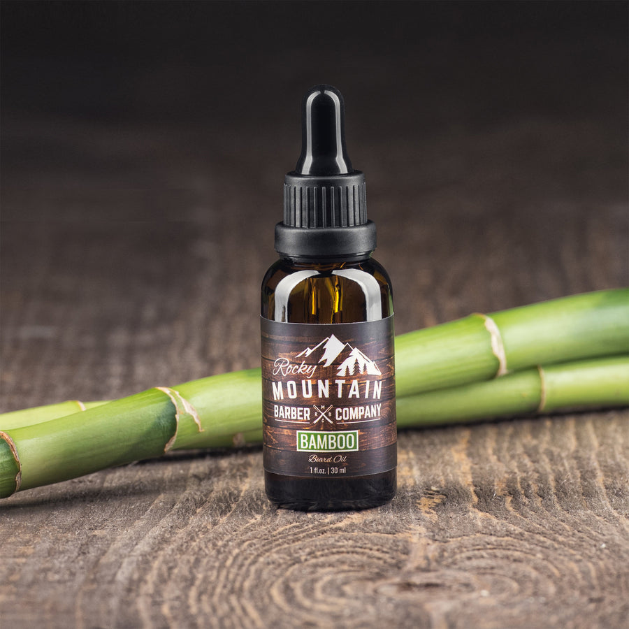 Rocky Mountain Barber Company Bamboo Beard Oil on Wooden Table with Bamboo