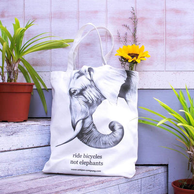 """ride bicycles not elephants"" tote bag"