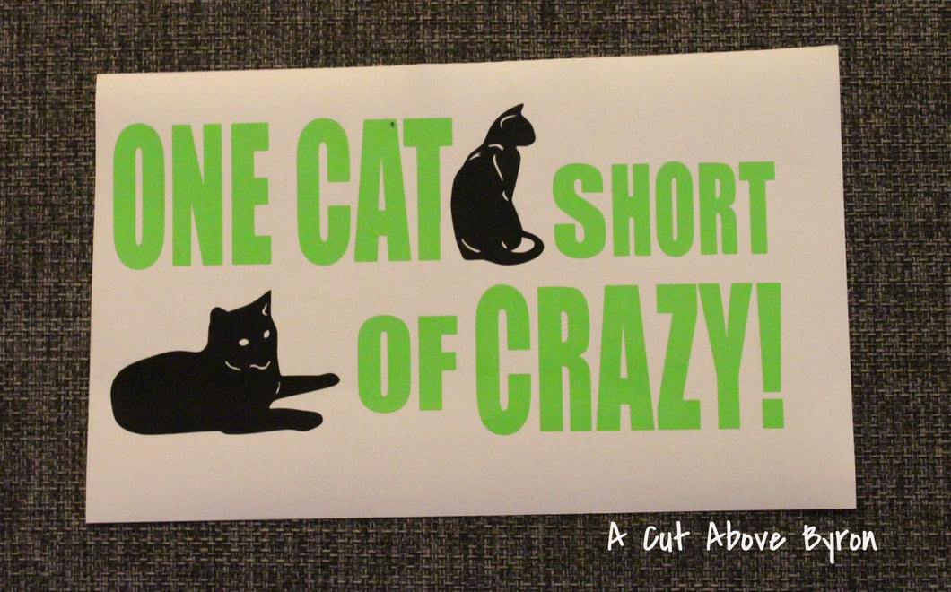 One cat short of crazy in green / black