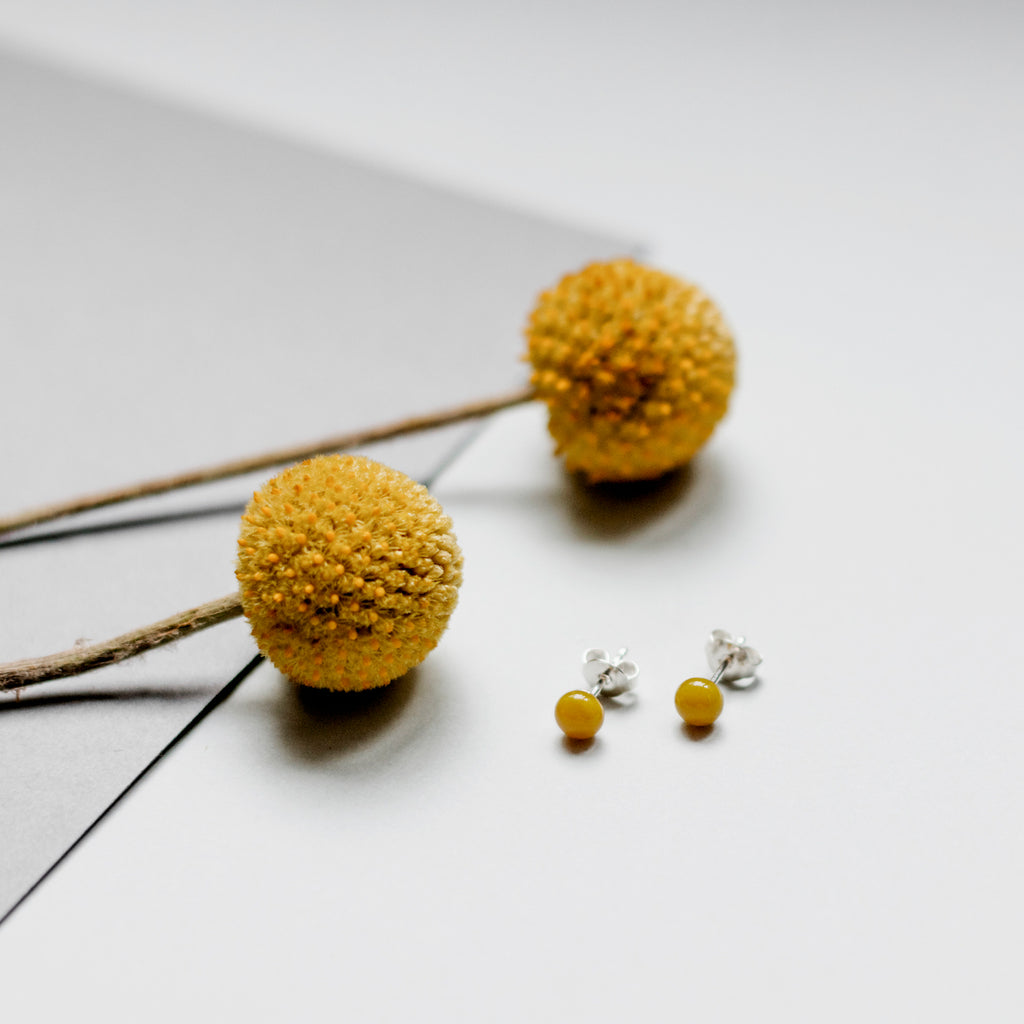 Pin earrings in mustard