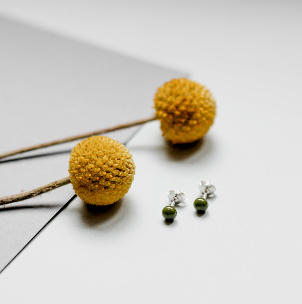 Pin earrings in olive