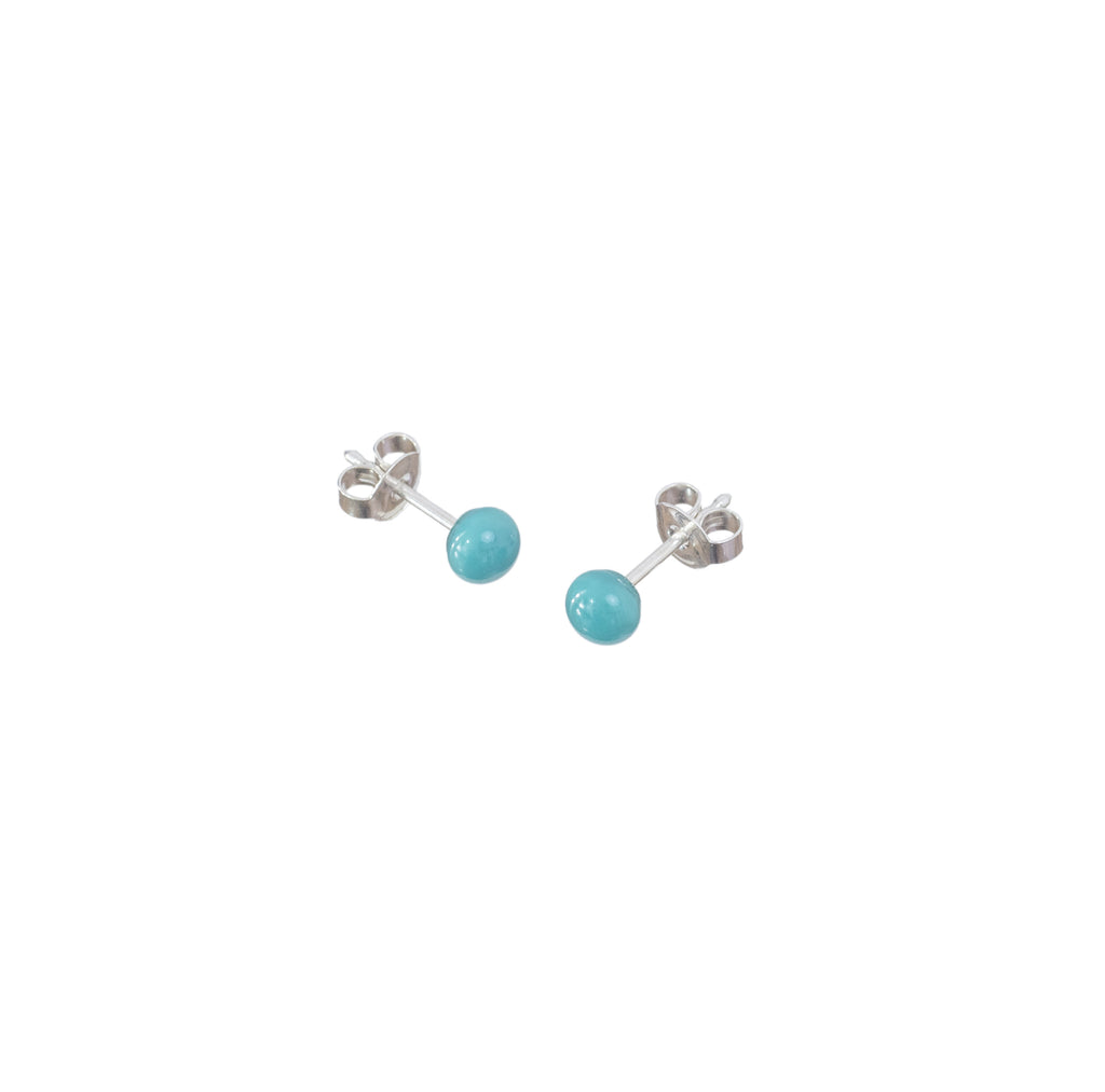 Pin earrings in teal