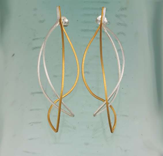 Kinetic earrings silver and gold ribbons