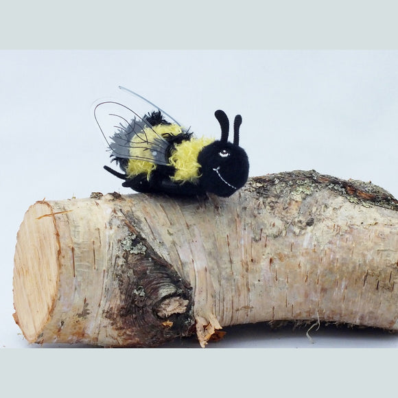 Bee Finger Puppet, yellow and black stripes with transparent wings.