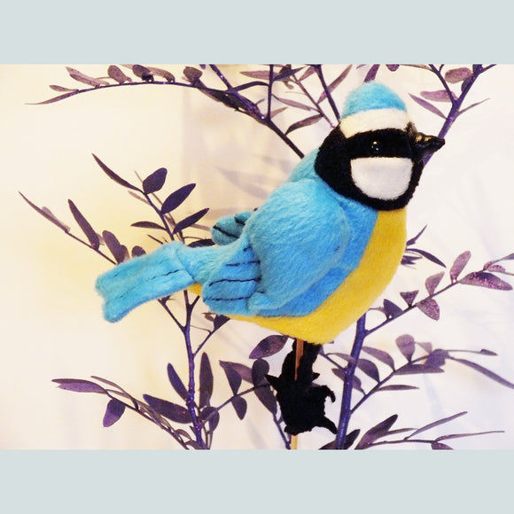 Blue tit finger puppet with realistic markings.