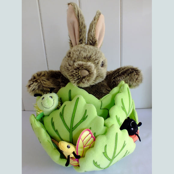 Rabbit hand puppet hiding in a fabric lettuce with 3 finger puppet friends, a caterpillar, ladybird and butterfly.