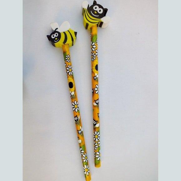 Pencils with honey bee erasers on the end.
