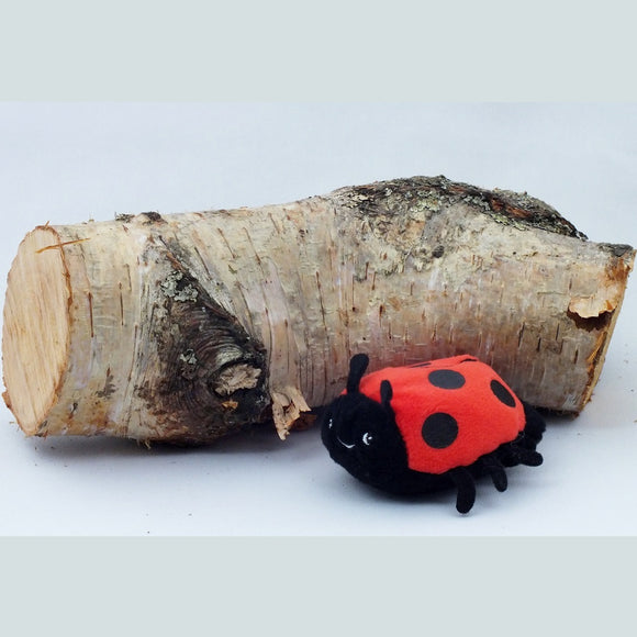 Ladybird finger puppet, red and black with a smiley face.