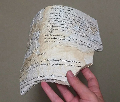 First foam pauldron piece with aged paper