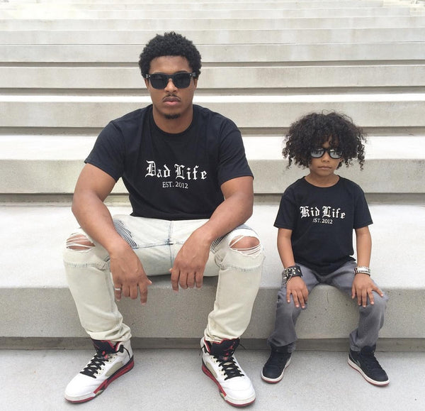 father and son wearing dad life and kid life with custom year established black t shirts