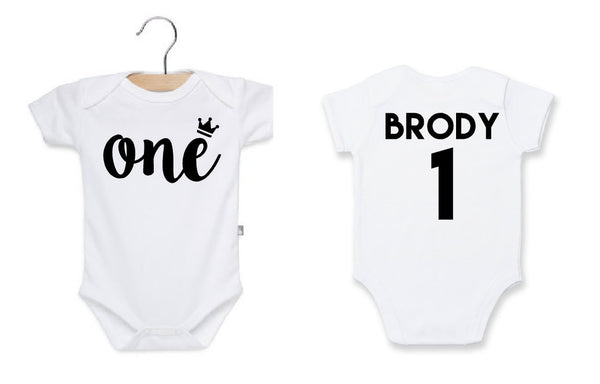 First birthday onesie in white with personalized name on the back.