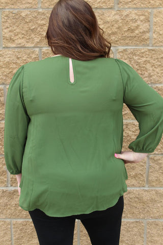 Green olive 3/4 sleeve plus size top, with keyhole back and gold button detail on the shoulders.