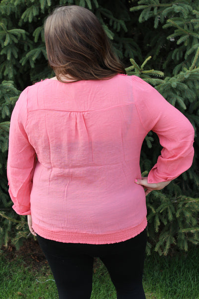 Light pink 3/4 button sleeve embroidered plus size top.