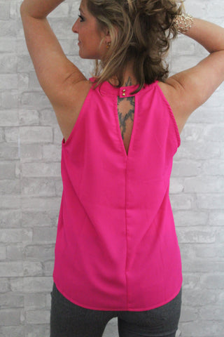 Hot pink halter top with keyhole back.