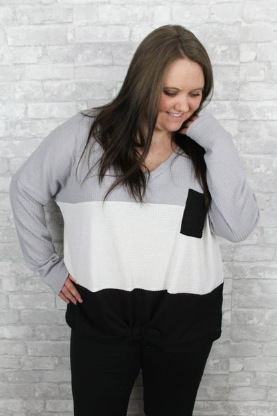 Gray, black, and white tiered waffle knit plus size long sleeve v-neck top with self-tie detail in front.  Lightweight and comfortable.