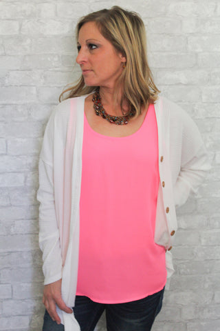 Light and bright pink tank top.