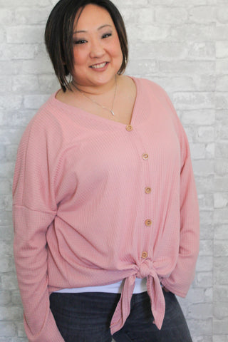 Blush pink waffle knit plus size long sleeve button-up with self-tie detail in front.  Lightweight and comfortable.