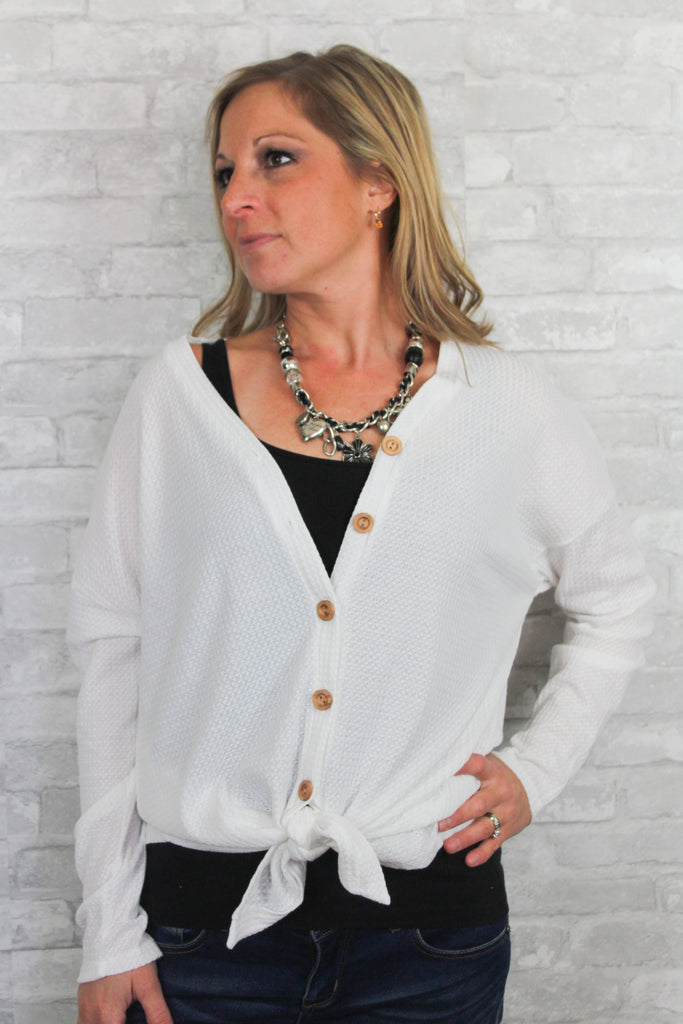 White waffle knit long sleeve button-up with self-tie detail in front.  Lightweight and comfortable.