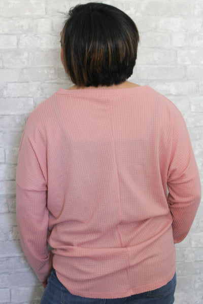 Blush pink waffle knit plus size long sleeve v-neck top with self-tie detail in front.  Lightweight and comfortable.