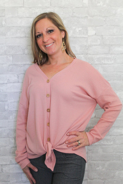 Blush pink waffle knit long sleeve button-up with self-tie detail in front.  Lightweight and comfortable.
