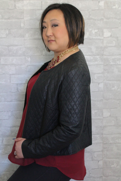 Maroon plus size tank top with black jacket.