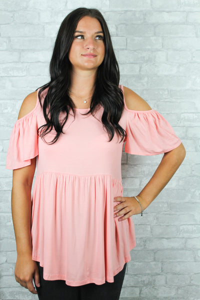 Blush pink cold shoulder top with ruffle arms.